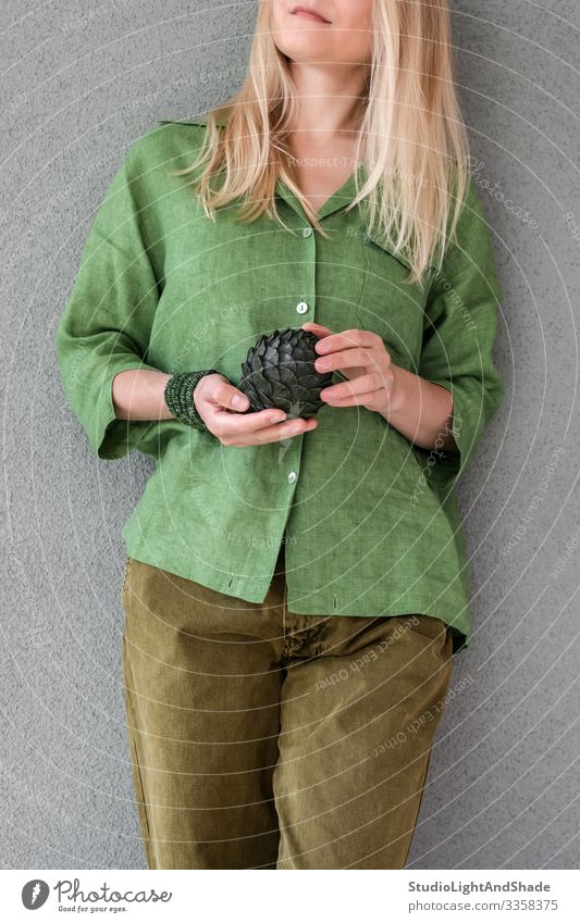 Woman in green clothes holding artichoke Beautiful Summer Human being Young woman Youth (Young adults) Adults Art Fashion Clothing Shirt Pants Jeans Blonde