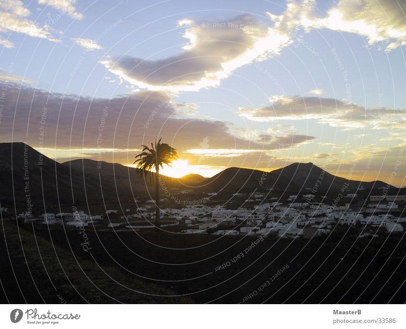 Clouds Mountain Europe Desert Village Palm tree Oasis Canaries Lanzarote