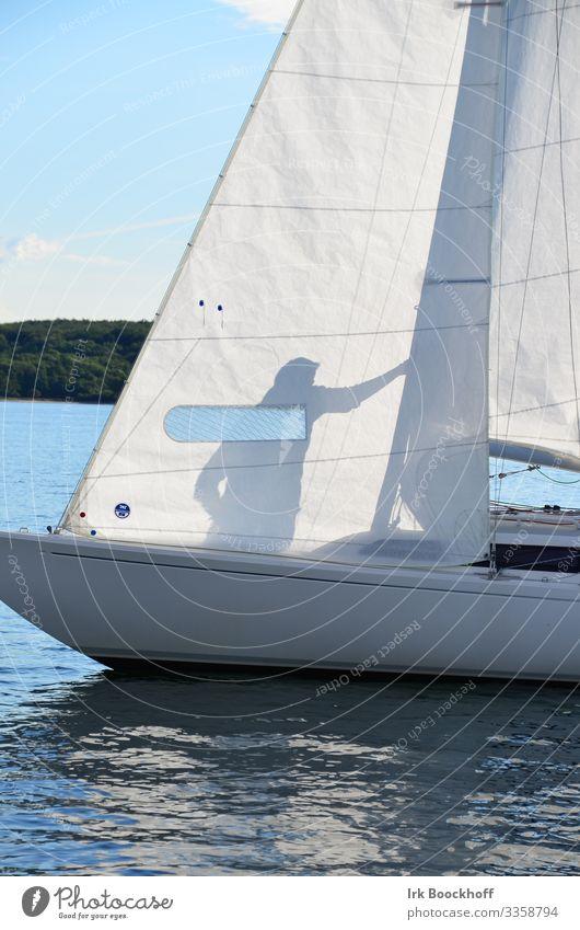 Shadow play on a sailing boat Leisure and hobbies Sailing Summer Summer vacation Sun Ocean Aquatics 1 Human being North Sea Baltic Sea Sport boats Yacht