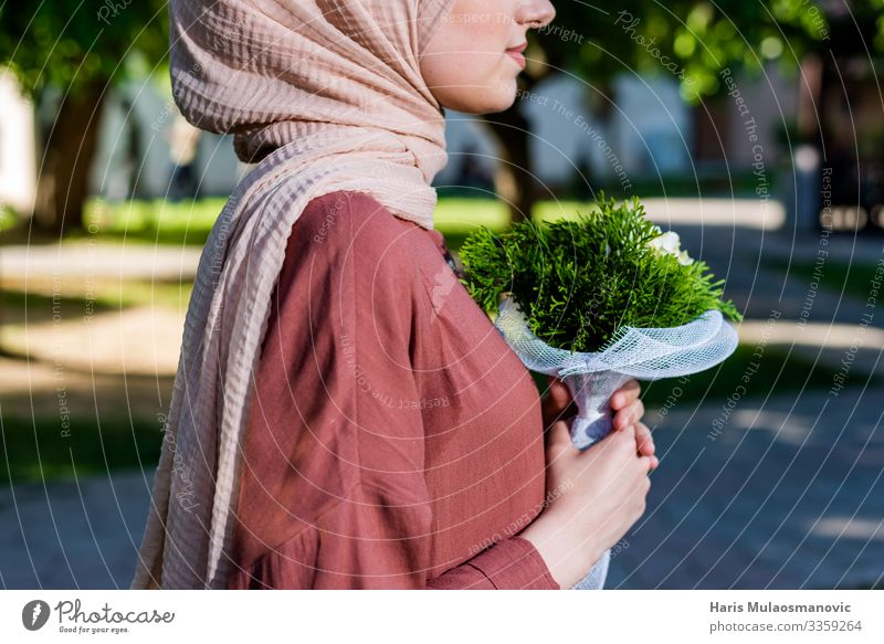 Muslim girl wearing hijab with flowers elegance Lifestyle Elegant Joy Human being Feminine Young woman Youth (Young adults) Body Chest Hand 1 18 - 30 years