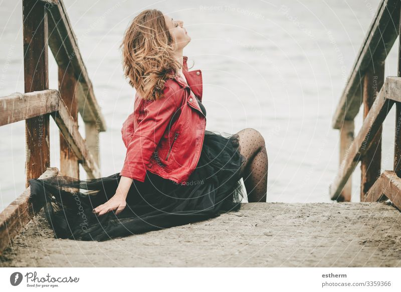 Pensive Young Woman sitting on the floor Lifestyle Elegant Style Beautiful Vacation & Travel Freedom Ocean Human being Feminine Young woman Youth (Young adults)