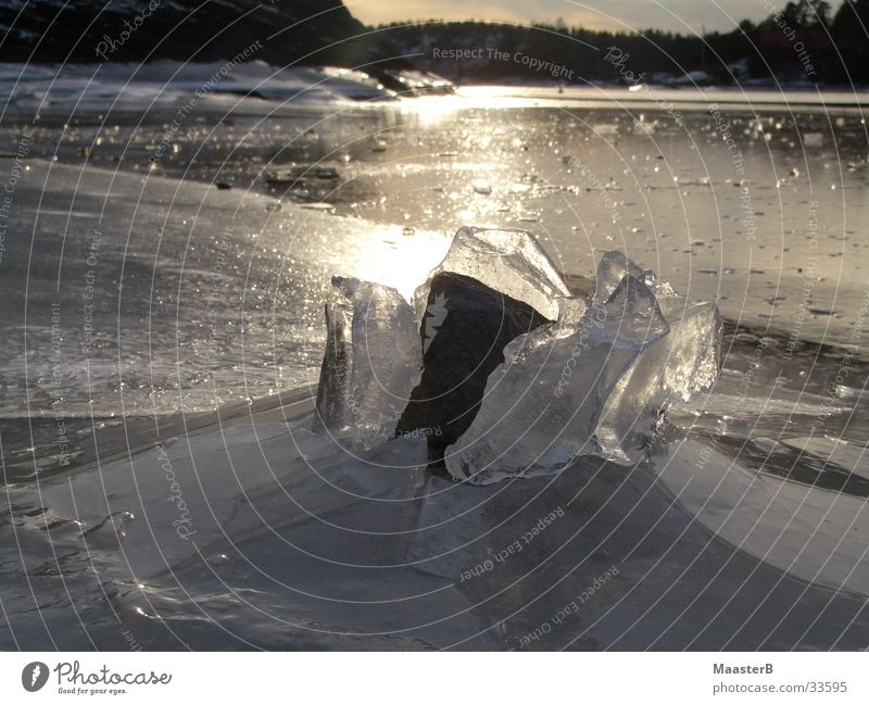 cracking the ice Island Nature Ice Frost Fjord Norway Stone Power Bizarre Frozen surface Sandvika broken ice Exterior shot Deserted Twilight Reflection Breach