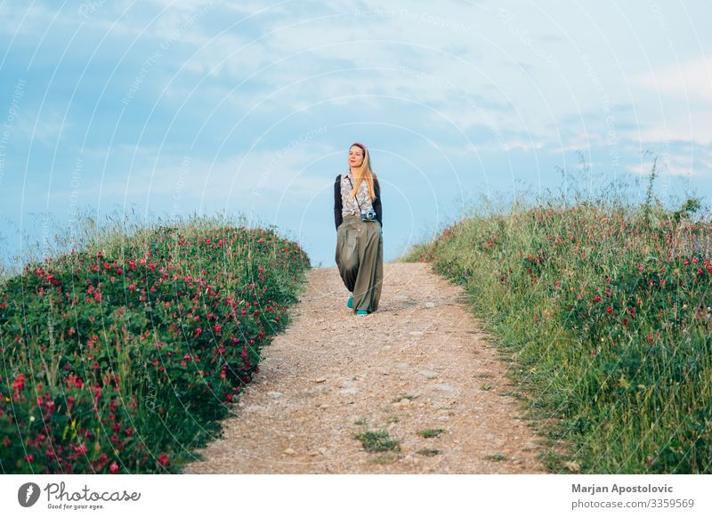 Young woman walking in countryside in Tuscany, Italy Lifestyle Vacation & Travel Tourism Trip Adventure Freedom Camera Feminine Youth (Young adults) Woman