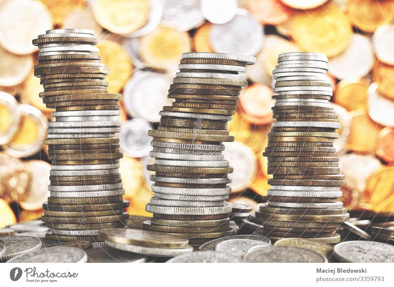 Wobbly towers made of diverse old coins. Lifestyle Shopping Luxury Happy Money Game of chance Lottery Night life Economy Financial Industry Stock market