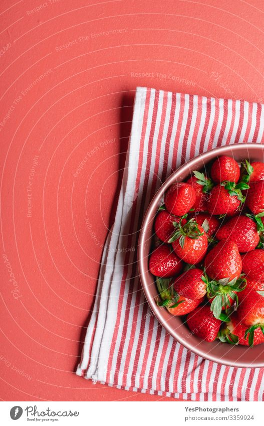 Organic strawberries in a tray on table. Fresh summer fruits Fruit Dessert Organic produce Vegetarian diet Diet Plate Bowl Delicious Natural Sweet Red