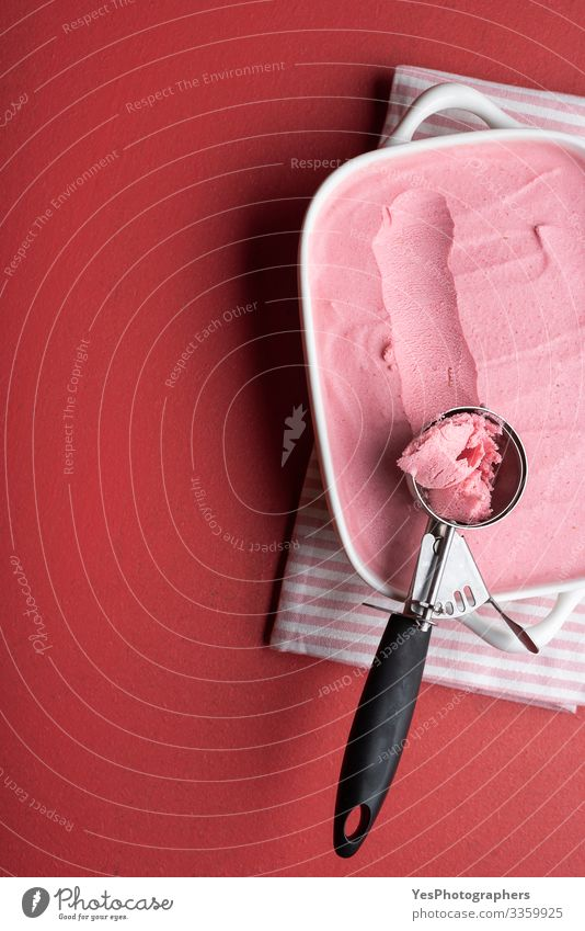 Raspberries ice cream tray with a scoop. Homemade ice cream Dairy Products Dessert Ice cream Italian Food Cool (slang) Fresh Delicious Sweet Pink Red above view
