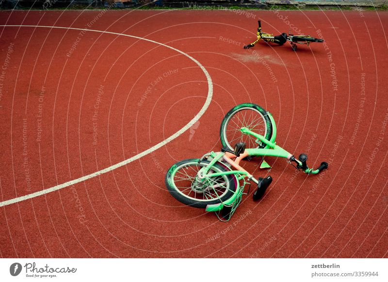 Two bicycles Bicycle Cycling tour Wheel Kiddy bike Playing Playground 2 In pairs Lie Basketball Playing field Circle Semicircle Berlin City Life Schöneberg Town