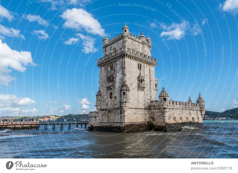 View of the west side of the Belem tower in Lisbon Vacation & Travel Tourism Sightseeing Architecture Landscape Water Sky Clouds Spring River bank Ocean