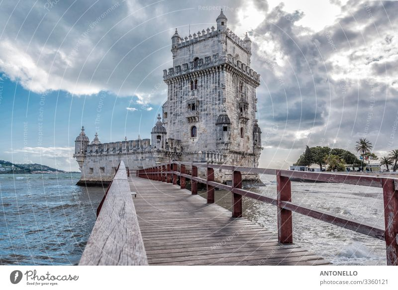 Footbridge and east side of Belem Tower in Lisbon Vacation & Travel Tourism Sightseeing City trip Architecture Water Sky Clouds Sunlight Spring Coast Ocean
