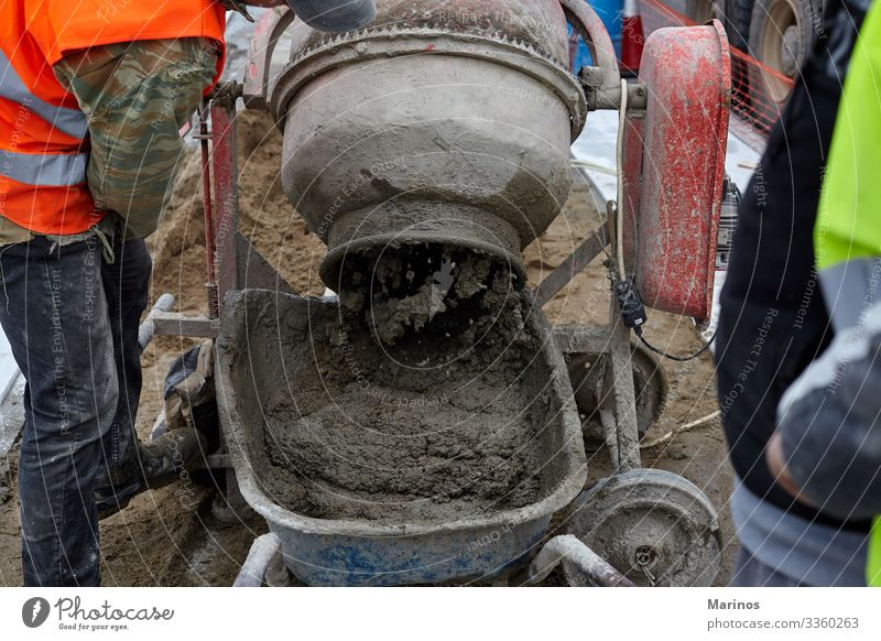 workers makes concrete with machine. Work and employment Craftsperson Industry Man Adults Tube Concrete Metal Wet Gray liquid Site Cement Story construction