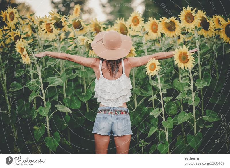Back view of Young Woman in Sunflower Field Lifestyle Joy Beautiful Wellness Vacation & Travel Freedom Summer Human being Feminine Young woman