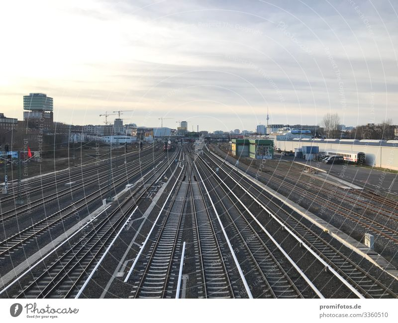 Alle Schienen führen nach Berlin. Town Capital city Train travel Railroad Positive Blue Gray Responsibility train Train station Railroad tracks Climate change