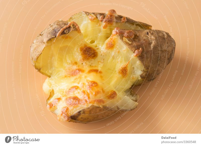 Jacket potatoes with cheddar cheese Cheese Diet England food Baking Cooking brown background Potatoes shredded Colour photo