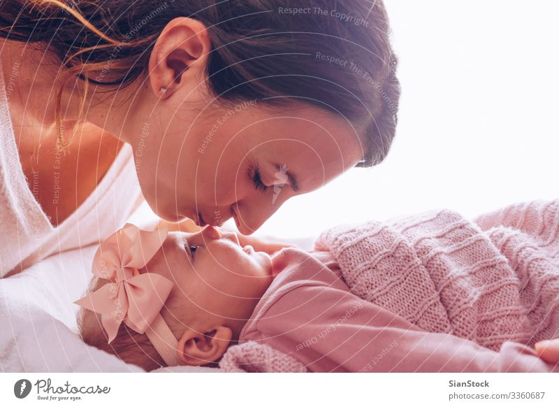 Young mother kissing her adorable baby girl. Joy Happy Beautiful Playing Child Baby Woman Adults Parents Mother Family & Relations Infancy Kissing Smiling Love