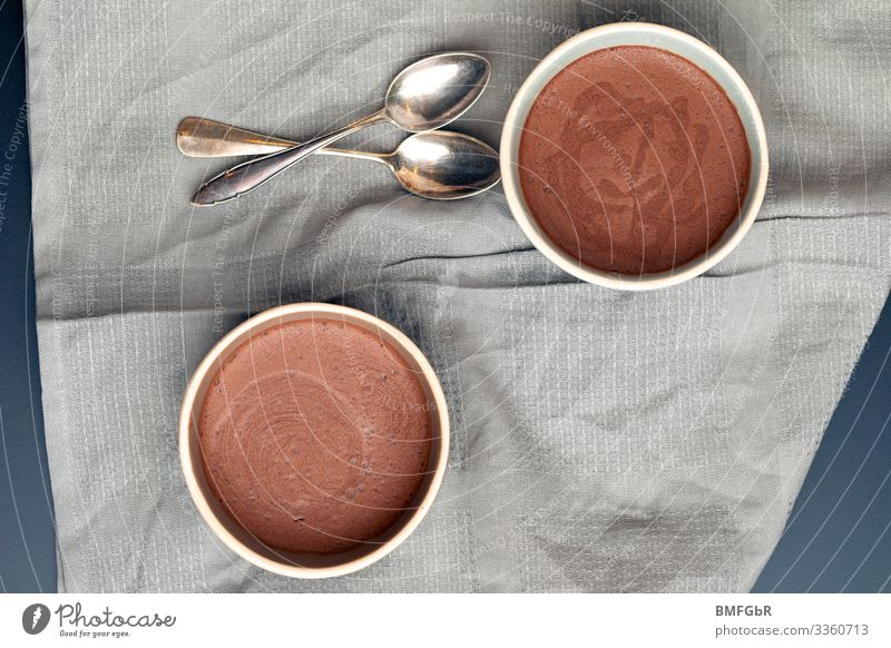 Delicious chocolate mousse Food Dessert Candy Chocolate Mousse au chocolat Nutrition Crockery Bowl Cutlery Spoon Dessert spoon Dish towel Sweet Brown To enjoy