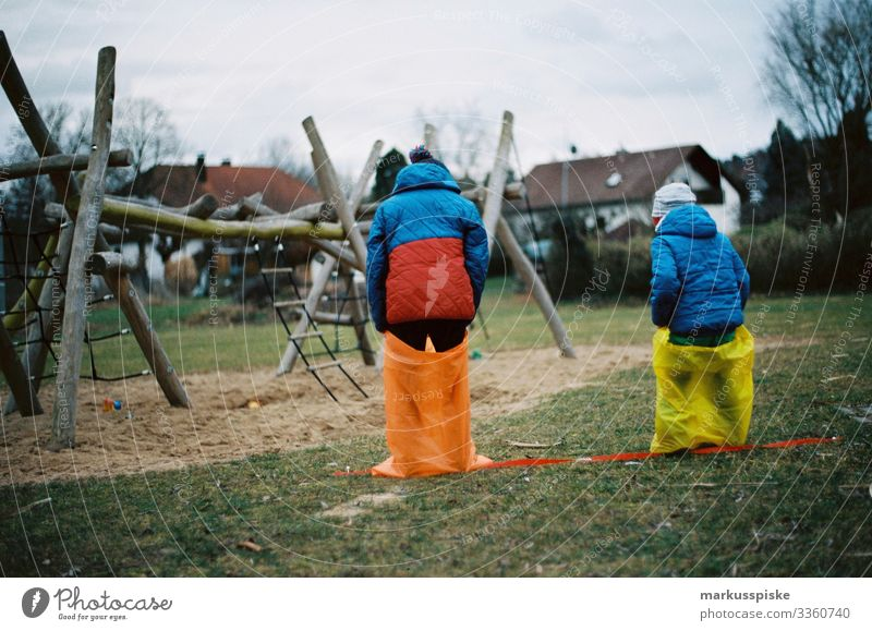 Two Boys Sack Race analog photography Analog analogue photography 35mm film photography Film Scan Leica R7 colorful red yellow outdoor child kids children