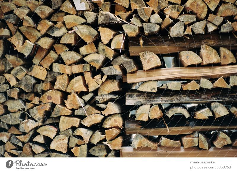 Stack of firewood Stack of wood Firewood Wood Sustainability Emission emission rights emission-neutral Warmth analog photography Analog fuel