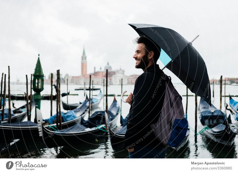 Young traveler in Venice, Italy on a rainy day Lifestyle Vacation & Travel Tourism Trip Sightseeing City trip Human being Masculine Young man
