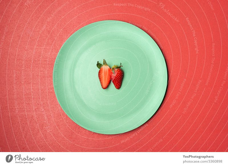 One strawberry cut in half on green plate Food Fruit Dessert Candy Nutrition Breakfast Organic produce Plate Delicious Natural above view Berries