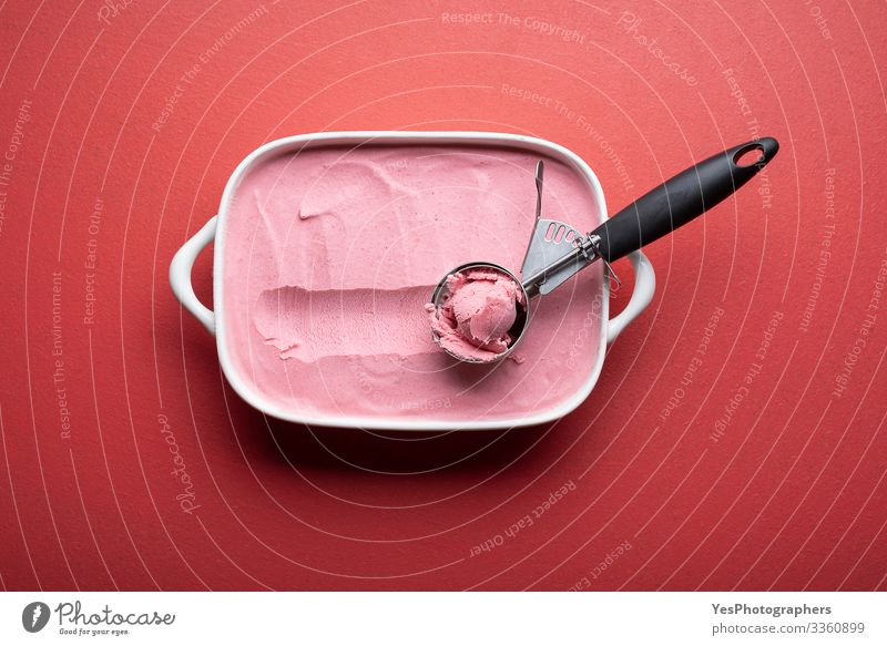 Raspberries ice cream with scoop on red table Food Dairy Products Fruit Dessert Ice cream Cool (slang) Fresh Delicious above view ceramic dish cold colorful