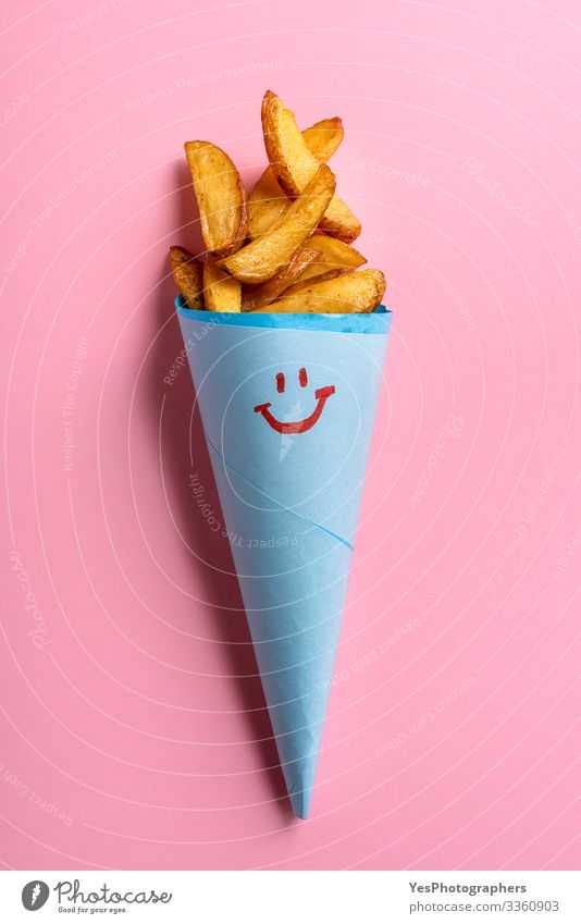 Roast potatoes in blue paper cone on pink background Food Vegetable Dinner Vegetarian diet Fast food Delicious Funny Cute Gold above view american fries