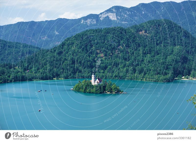 Traditional Pletna boats around Bled island on lake Bled Vacation & Travel Summer Beach Air Traffic Control Tower Stupid Religion and faith sky green water