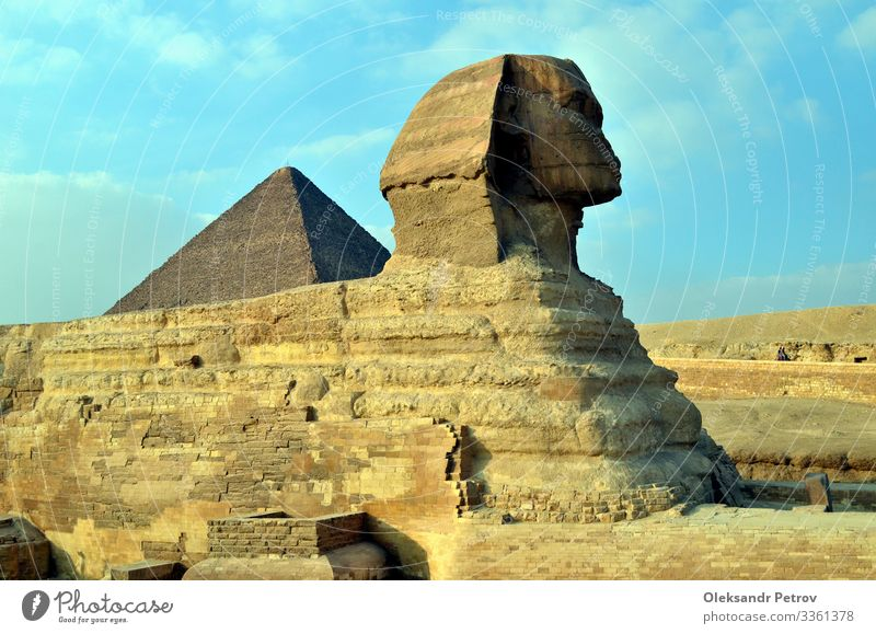 Sphinx is sitting in the desert for ages looks like camel Vacation & Travel Tourism Sand Sky Architecture Monument Stone Old Historic Egypt pyramid Cairo