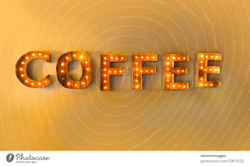 Encased letter lights yellow wall reading coffee Beverage Hot drink Coffee Espresso Style Design Joy Lamp Night life Signage Warning sign Glittering Bright