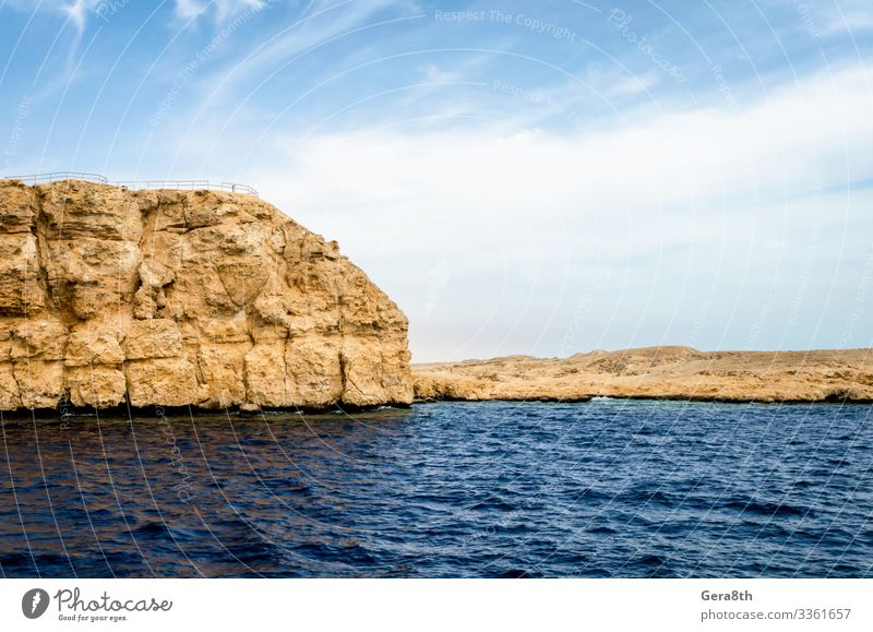 rocky coast of the Red Sea andblue sky with clouds Exotic Vacation & Travel Tourism Trip Summer Ocean Island Nature Landscape Sand Sky Clouds Horizon Climate