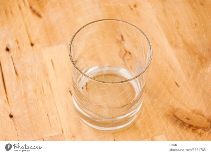 The glass is already completely empty - a single empty glass on a wooden table. Glass Empty drinking glass Tumbler Thirst Beverage Drinking Services