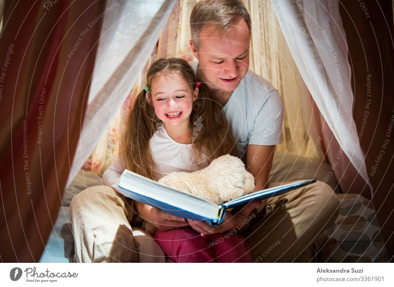 Family quality time. Father and daughter Sleep Book Friendliness Cheerful Child Infancy Cozy Cute dad Daughter Education Entertainment Family & Relations Joy