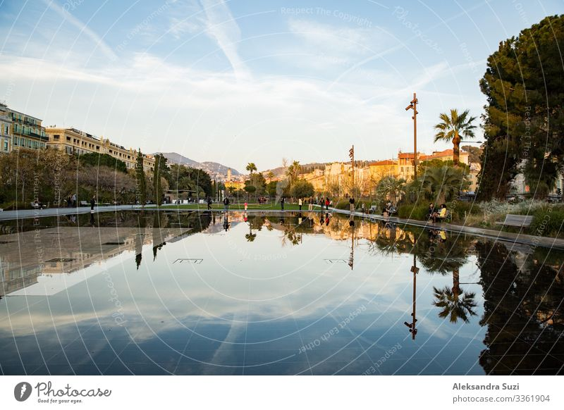 Nice, France - 20.03.2018: fountains of Promenade du Paillon, reflections on water surface, sunset. Architecture Building City editorial Europe Fountain French