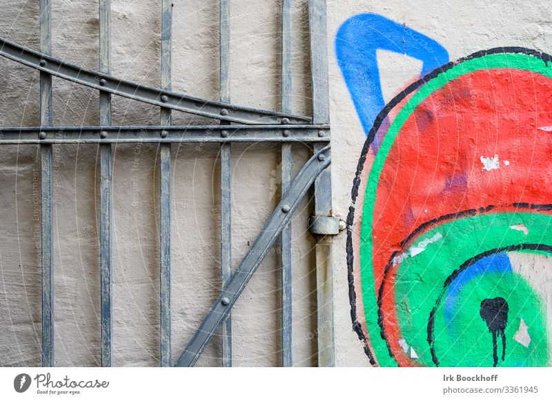 Graffiti of a cat next to the entrance gate Living or residing Goal Subculture Downtown Wall (barrier) Wall (building) Door Stone Metal Cute Emotions