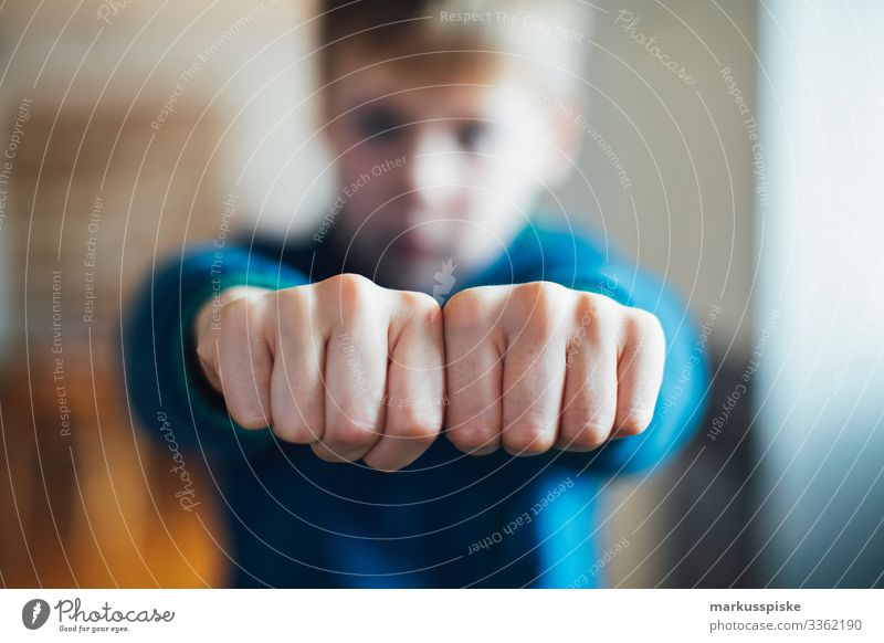 Boy shows clenched fists Boy (child) Infancy Children's game Fingers hands Symbols and metaphors symbolic power Symbolism Aggression aggressively Fist