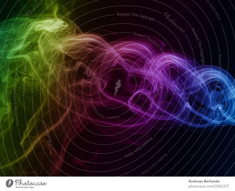 Abstract rainbow colored smoke on black green yellow elegant backdrop form detail aroma slow science fog horror studio fumigate texture mystery fumes movement