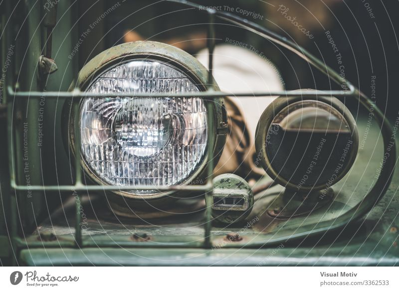 Left front lamp of a WWII GMC 352 Design Lamp Transport Vehicle Metal Steel Old Strong Green Colour interior metallic structure chassis powerful rim left