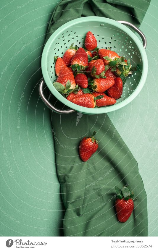 Ripe strawberries in a rustic colander. Fresh berries Fruit Dessert Candy Nutrition Organic produce Healthy Eating Sieve Delicious Natural above view
