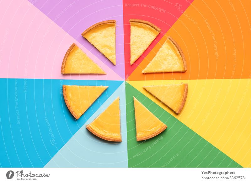 Sliced cheesecake on a rainbow background. Cake slices Food Dairy Products Dessert Candy Delicious Tradition above view bakery goods cheese cake cheese pie