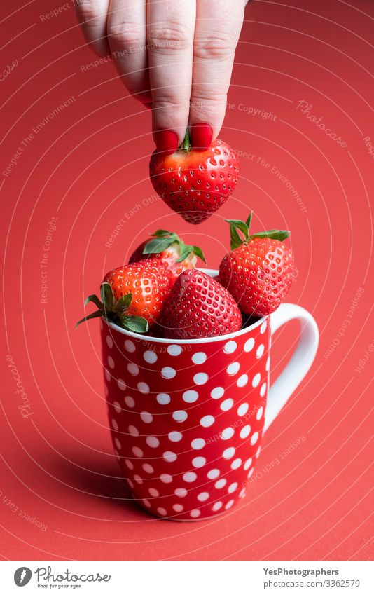 Taking a ripe strawberry from a pile. Cup of strawberries Food Fruit Dessert Candy Nutrition Breakfast Organic produce Mug Healthy Eating Feminine Hand