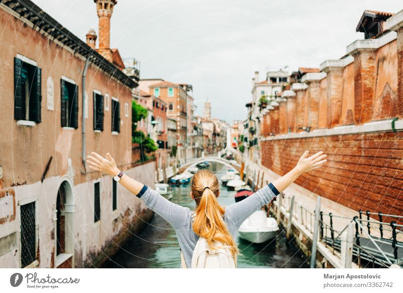 Young woman enjoying the view of the canal in Venice Lifestyle Joy Vacation & Travel Tourism Trip Adventure Freedom Sightseeing City trip Human being Feminine