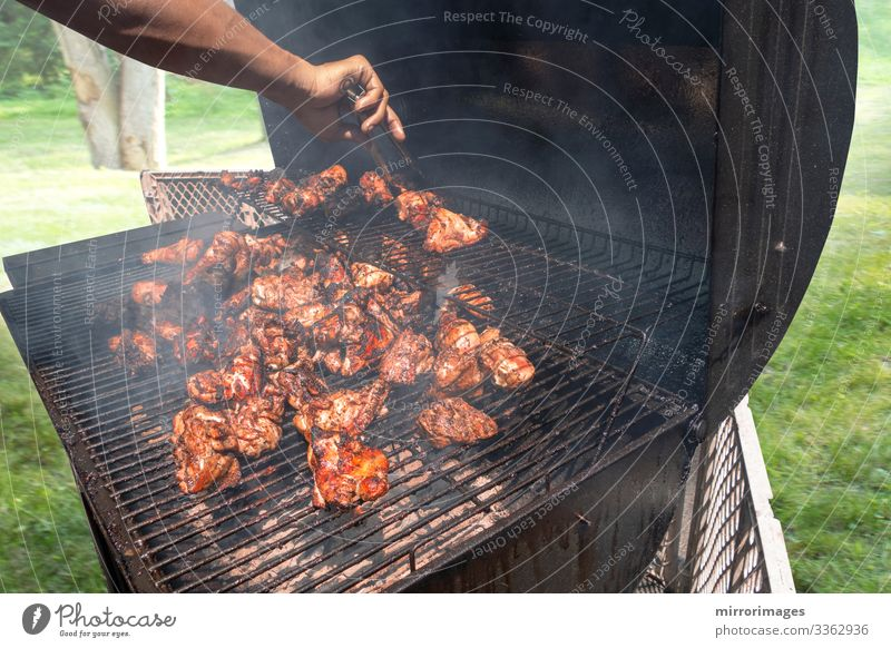 charcoal grill Suburban man grilling chicken for friends family Meat Lunch Dinner Organic produce Lifestyle Healthy Eating Summer Event Feasts & Celebrations