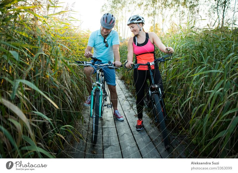 Happy couple working out together, leisure activity Action Adults Adventure Bicycle Cycling Cycling tour Friendliness Cheerful Couple Practice