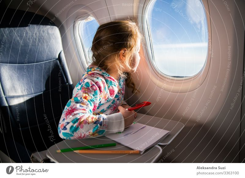 Child drawing picture with crayons in airplane Adventure Aviation Airplane Airplane landing Arrival boring Action Hut Infancy Colour Crayon Departure