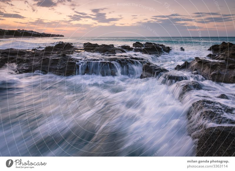 Crete. Beach Ocean Nature Rock Coast Blue Violet Europe Mediterranean Greece Greek Lasithi Ierapetra St. Andrew beach seascape wave Morning Dawn Sunrise Sunset