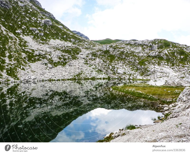 mountain lake Mountain Lake Reflection in the water Alps Water Nature Exterior shot Landscape Deserted Beautiful weather Summer Day Colour photo Sky Rock