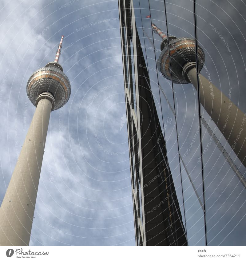 twins Sky Clouds Beautiful weather Berlin Town Capital city Downtown Tower Facade Window Tourist Attraction Landmark Berlin TV Tower Television tower Large Tall