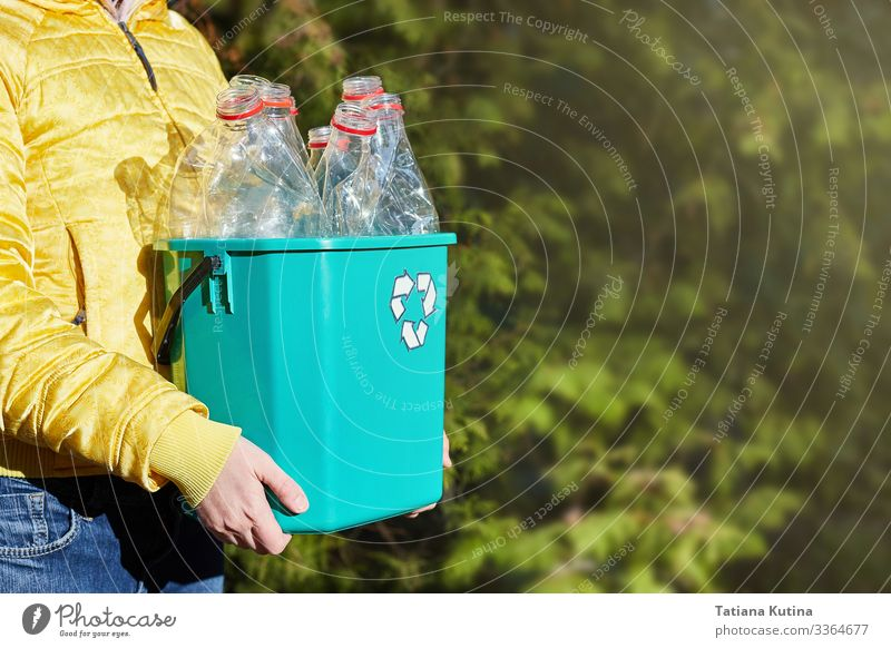 Girl's hands hold a box with empty plastic bottles. Bottle Industry Arm Hand Environment Earth Container Tin Plastic Clean Blue Green Black White