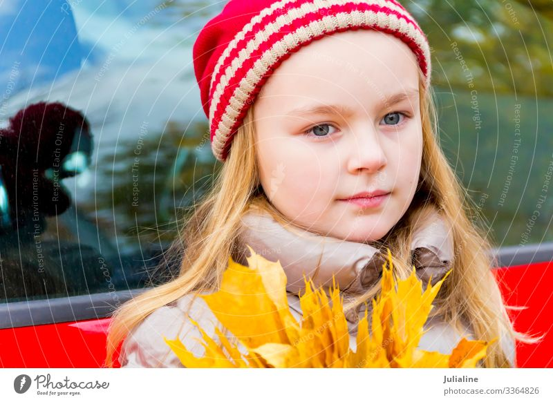 Cute girl in red hat Child Schoolchild Woman Adults Infancy Autumn Hat Blonde Smiling Blue Red White Emotions kid preschooler one Lady six 7 Caucasian European