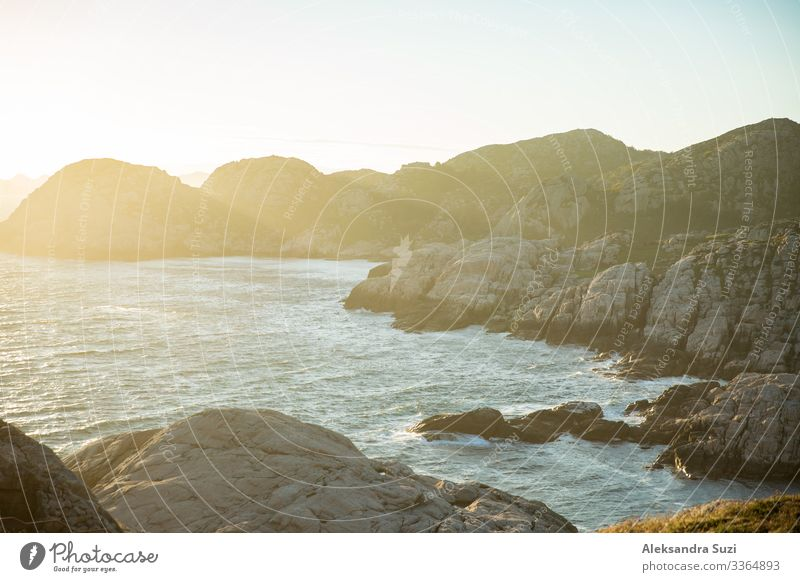 Serene Scandinavian summer landscape on south coast of Norway. Rocky Mountains, fjord from top. Sunset sky. Lindesnes Adventure Bay Beauty Photography Coast