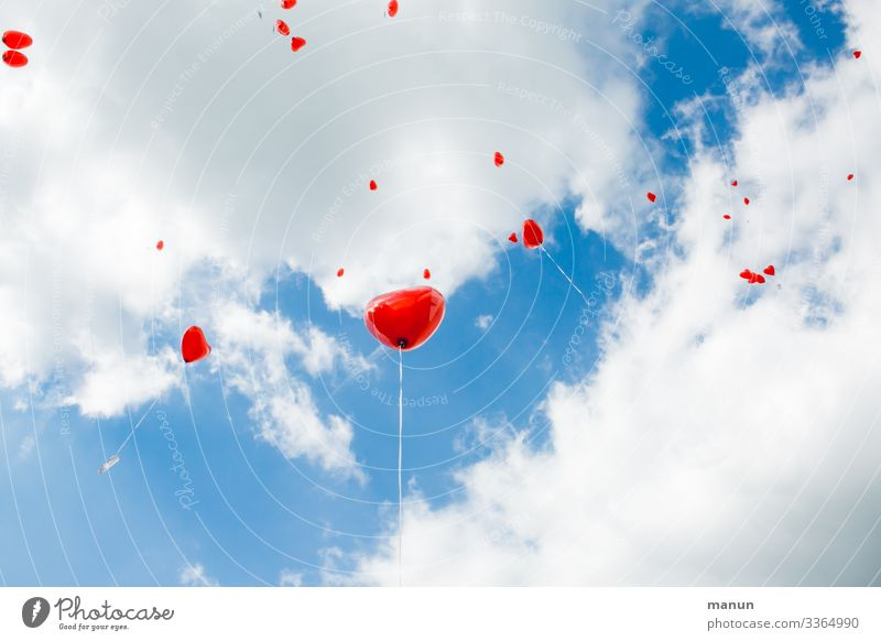 Heart-shaped balloons fly in front of a white-blue sky Floating Red Sky Wedding customs symbol Love